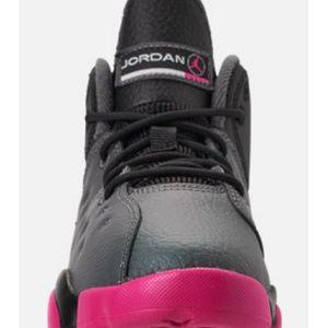 Black , grey and pink Jordans.